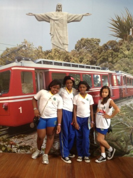 School children posing in front of mural at tram station