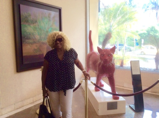 Black Kat Meets Red Cat in Hotel Lobby