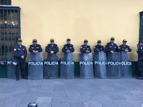 Policia in the Plaza waiting for something to jump off