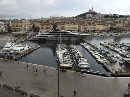 Kismet, A Superyacht, docked right in front of my penthouse suite