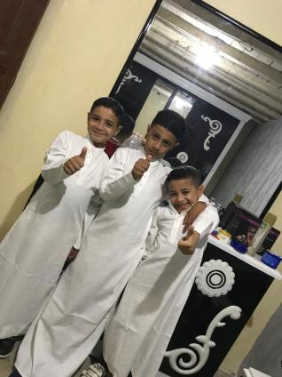 Nephews Ahmed, Farris, Reza wearing my gift for EID FEAST