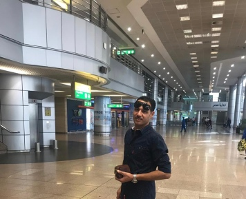 Hamada Mohamed Ahmed Nazim: At the airport, waiting for my wife
