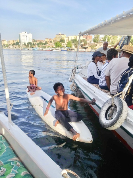 Playful Children Hanging on to Felucca